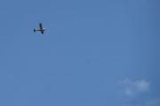 Lørdag - Et lite småfly går over oss, sikkert fint å se alle bilene derfra