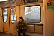 Inne på T-banevognen leker vi oss, min tur først