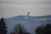 Fra parkeringsplassen der jeg skal gå inn ser vi Holmenkollen
