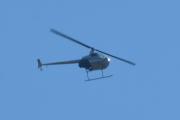 Morten 15 juli 2021 - Helikopter over Høyenhall, solen er skarp og han er akkurat utenfor rekkevidde